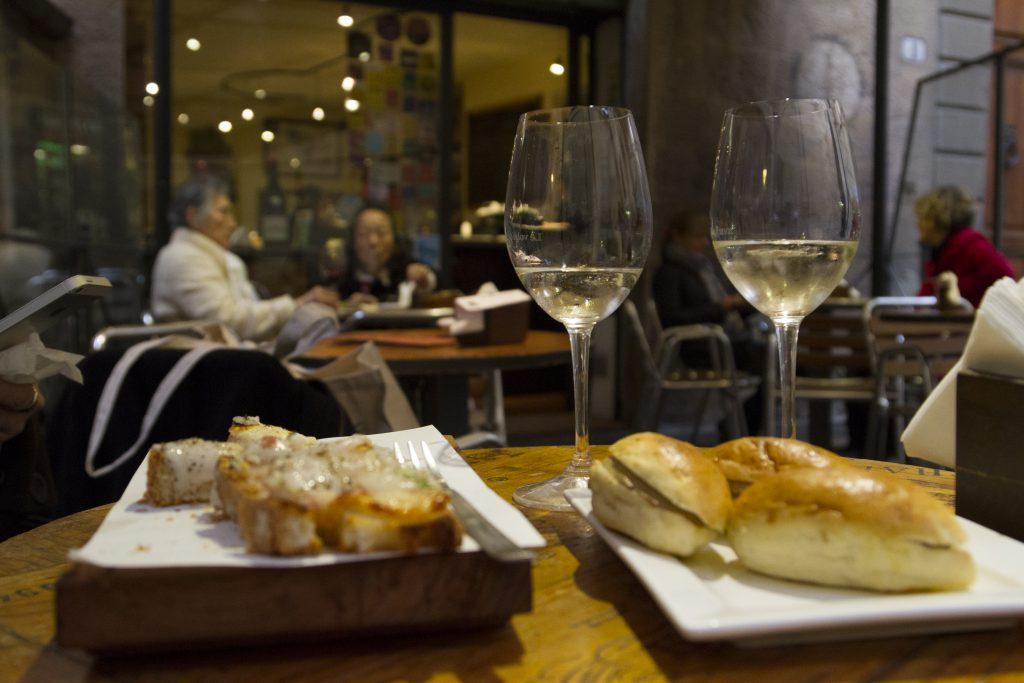 lardo crostini sipped with spumante franciacorta and truffle panini at Le Volpi e L'Uva