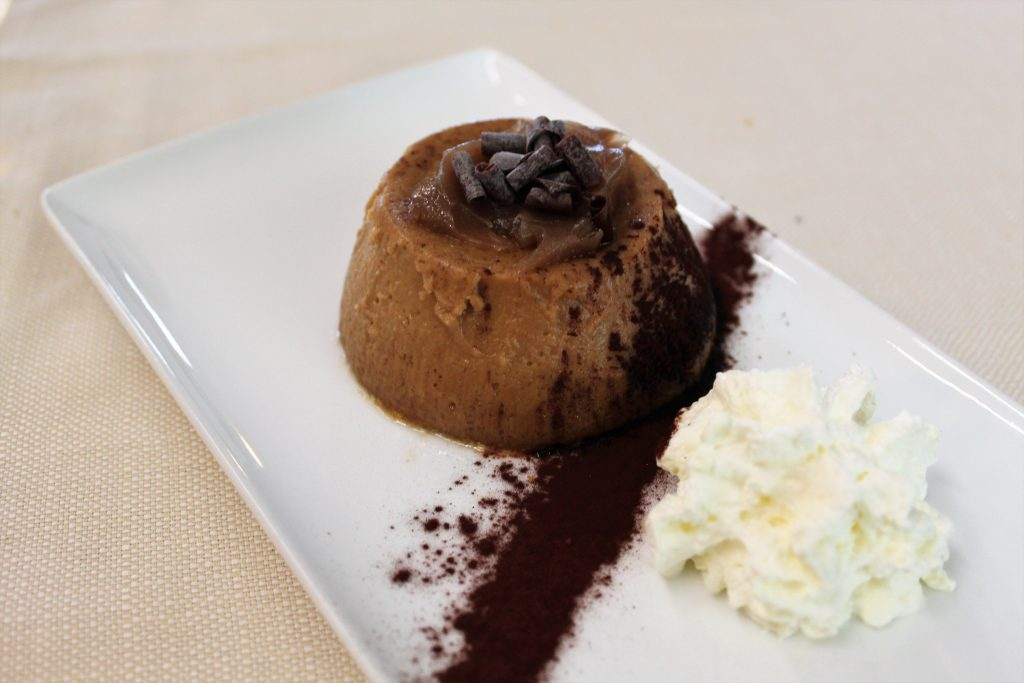Chestnut pudding with a heart of marron glace and shaved dark chocolate. And of course, panna.